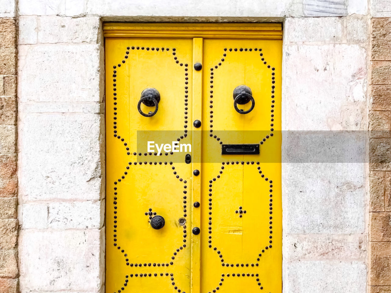 CLOSE-UP OF YELLOW WALL WITH DOOR