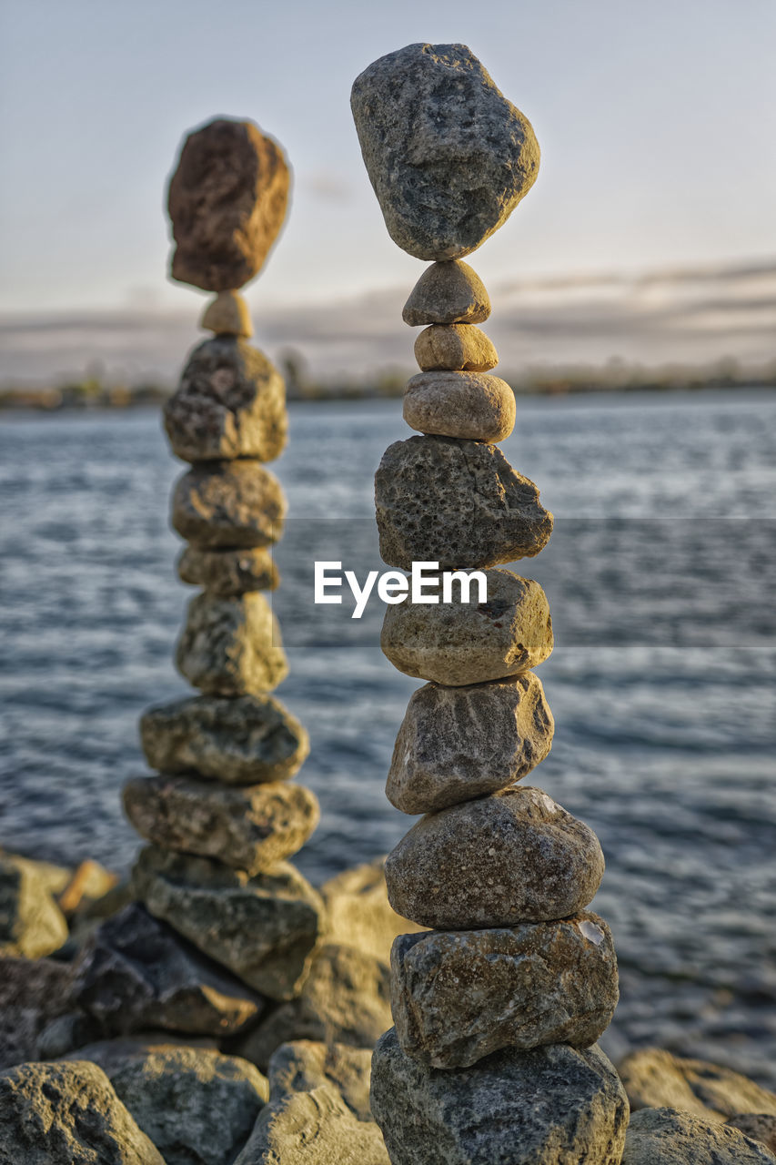 balance, stack, rock - object, sea, in a row, focus on foreground, pebble, water, zen-like, outdoors, day, tranquility, full length, beauty in nature, no people, sky, nature, close-up