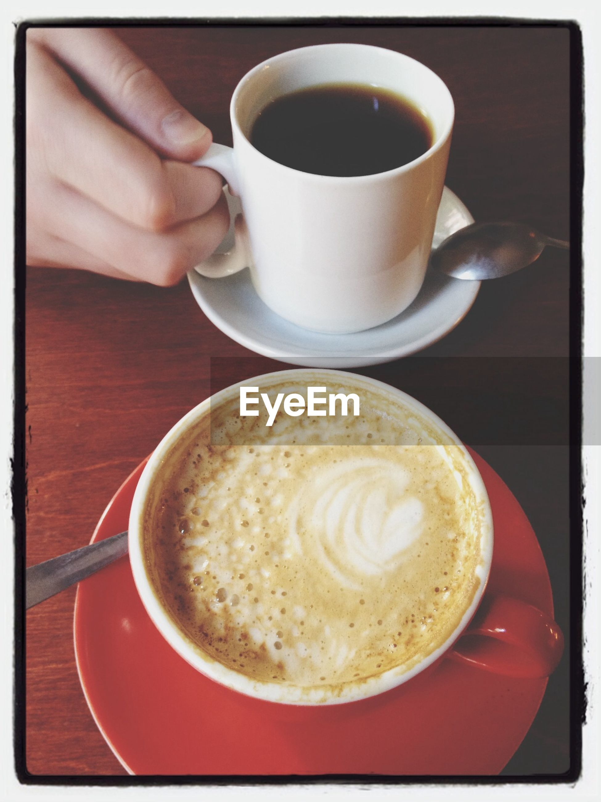 coffee cup, drink, food and drink, refreshment, coffee - drink, saucer, coffee, indoors, freshness, cup, frothy drink, cappuccino, table, froth art, spoon, hot drink, beverage, breakfast, one person, close-up