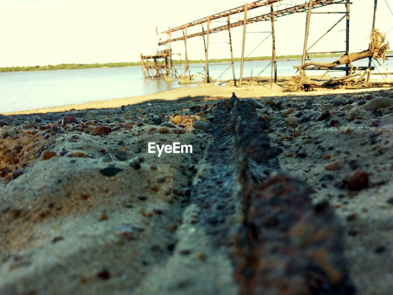surface level, water, outdoors, no people, sea, day, nature, beach, clear sky, bridge - man made structure, architecture, built structure, sky, beauty in nature, close-up