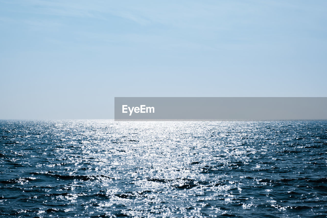 SCENIC VIEW OF SEASCAPE AGAINST CLEAR SKY