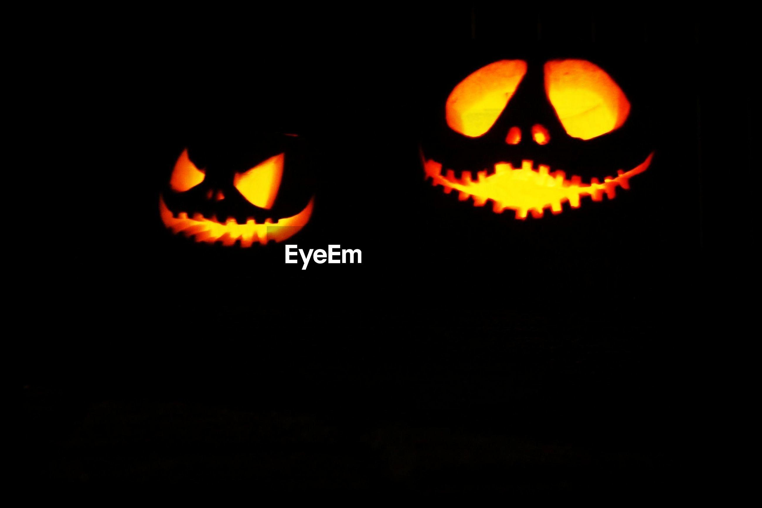 Illuminated jack-o-lanterns at night