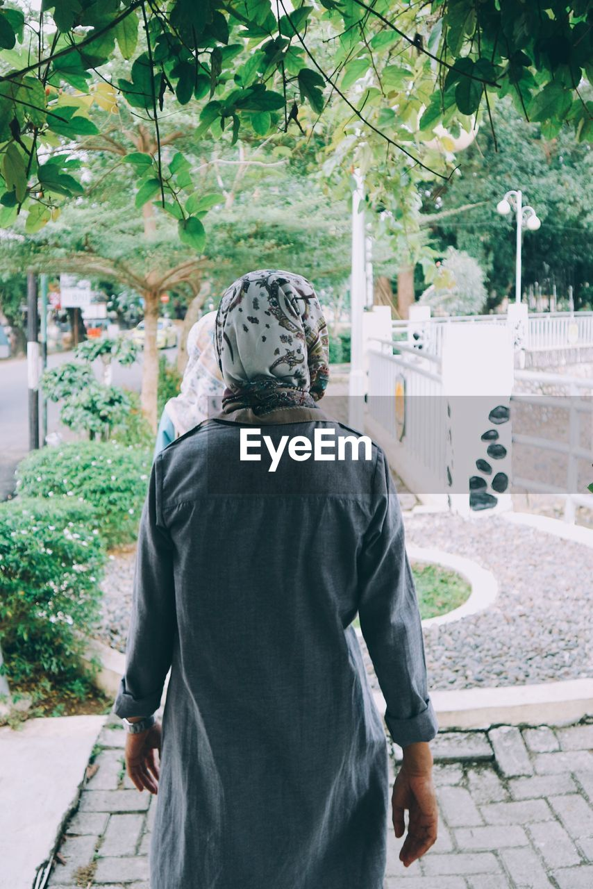Rear View Of Woman Walking At Park