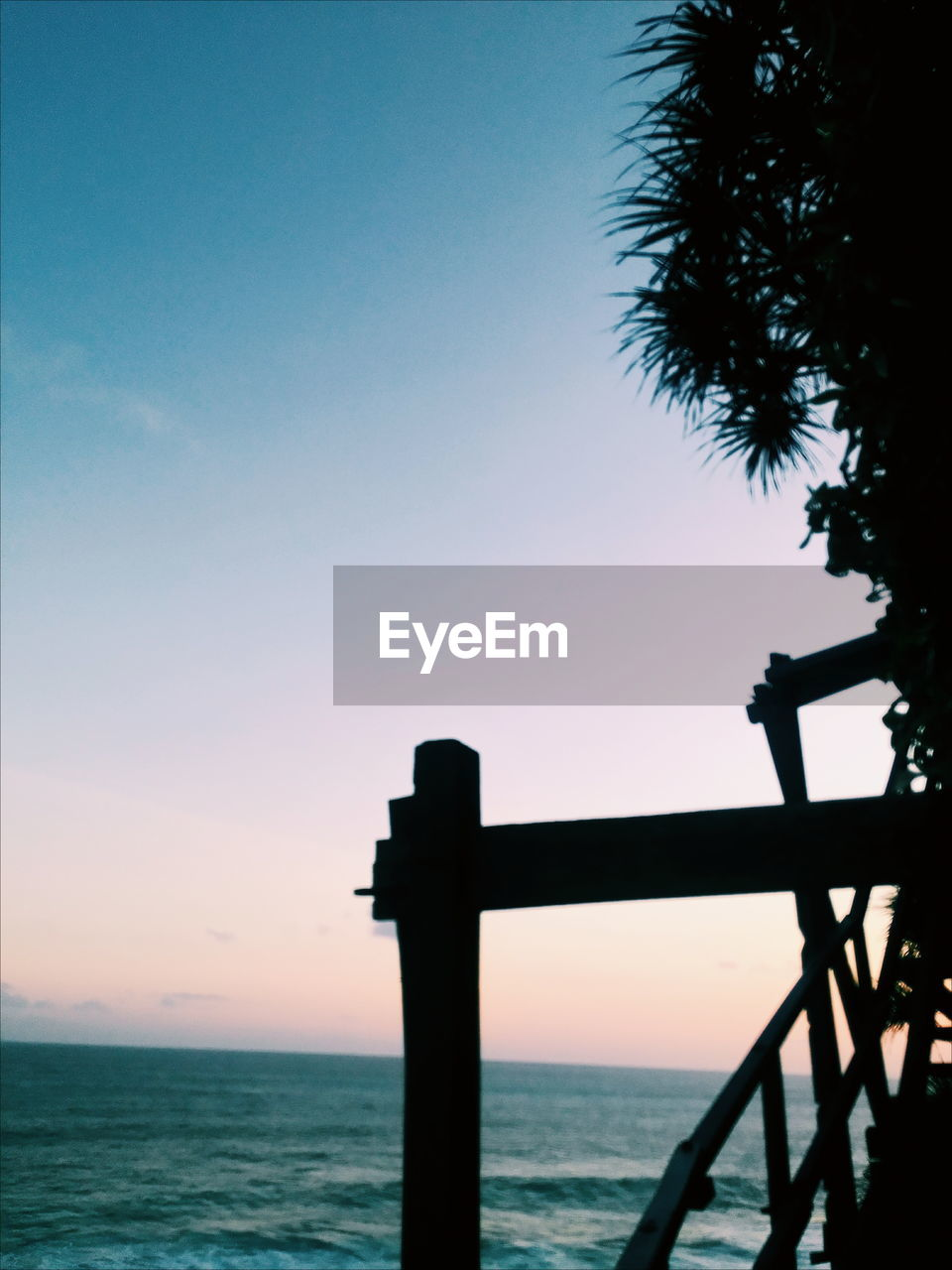 sky, sunset, water, sea, silhouette, beauty in nature, scenics - nature, horizon, tranquility, horizon over water, tranquil scene, nature, outdoors, orange color, tree, no people, copy space, clear sky, railing
