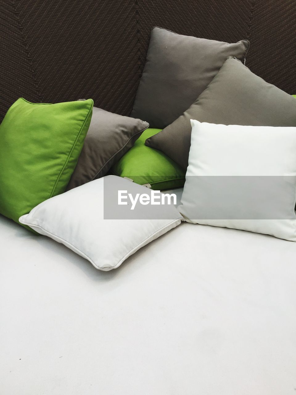 furniture, indoors, pillow, still life, high angle view, no people, bed, stuffed, cushion, sofa, relaxation, domestic room, green color, white color, paper, textile, sheet, bedroom, linen, comfortable, softness, duvet