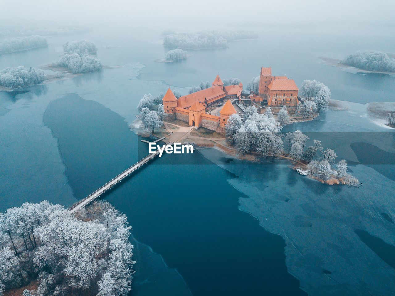 Aerial View Of Buildings Amidst Frozen Lake