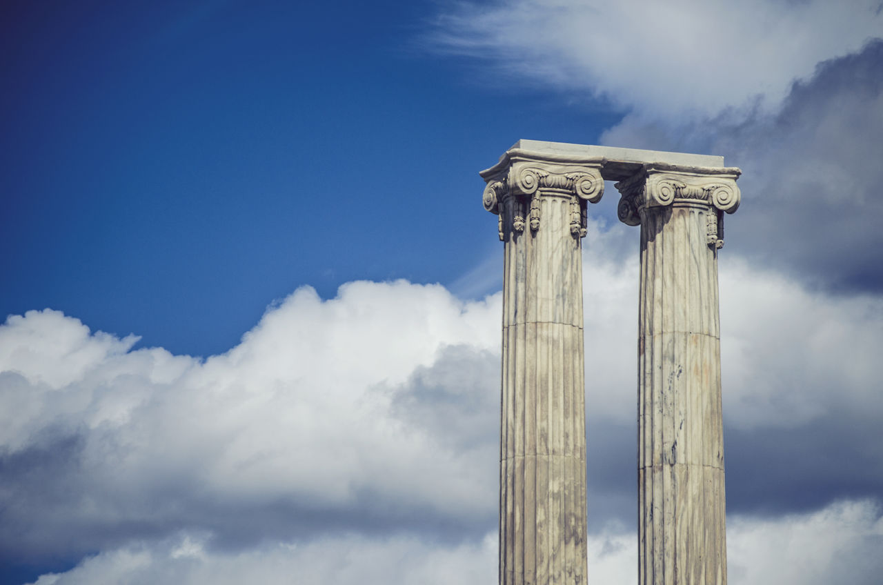 cloud - sky, low angle view, architectural column, sky, history, ancient, built structure, day, no people, architecture, outdoors, ancient civilization, travel destinations, blue, nature
