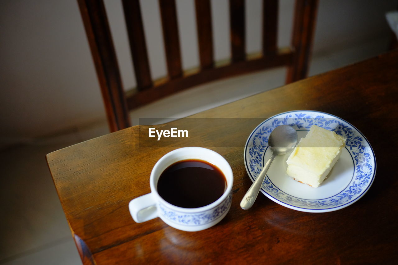 food and drink, table, refreshment, drink, cup, food, still life, mug, freshness, indoors, wood - material, coffee, coffee cup, coffee - drink, no people, high angle view, focus on foreground, seat, tea, plate, breakfast, crockery, non-alcoholic beverage
