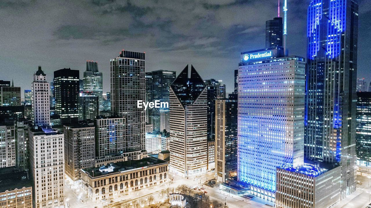 architecture, skyscraper, building exterior, built structure, modern, city, illuminated, cloud - sky, cityscape, sky, travel destinations, no people, urban skyline, night, outdoors, growth, office park