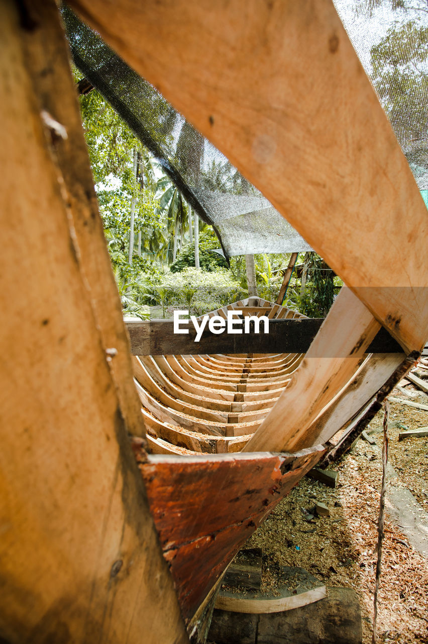 day, wood - material, close-up, plant, no people, nature, outdoors, metal, high angle view, tree, rusty, abandoned, architecture, old, damaged, built structure, weathered, obsolete, selective focus, run-down