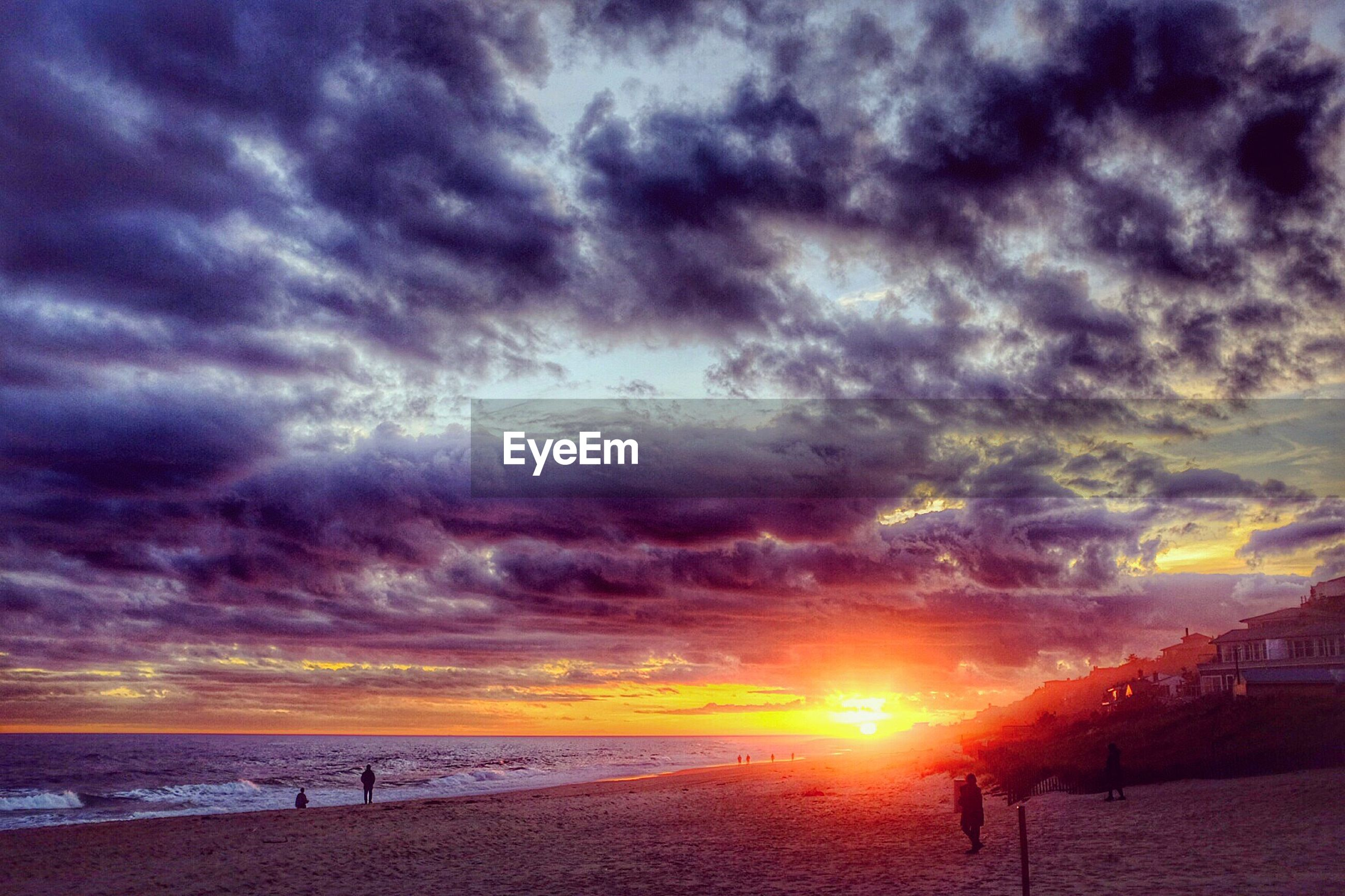Scenic view of cloudy sky over beach during sunset