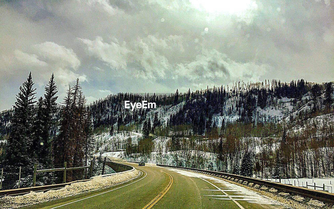 cloud - sky, sky, tree, plant, road, transportation, nature, direction, winter, cold temperature, no people, beauty in nature, snow, day, tranquility, scenics - nature, the way forward, tranquil scene, non-urban scene, outdoors