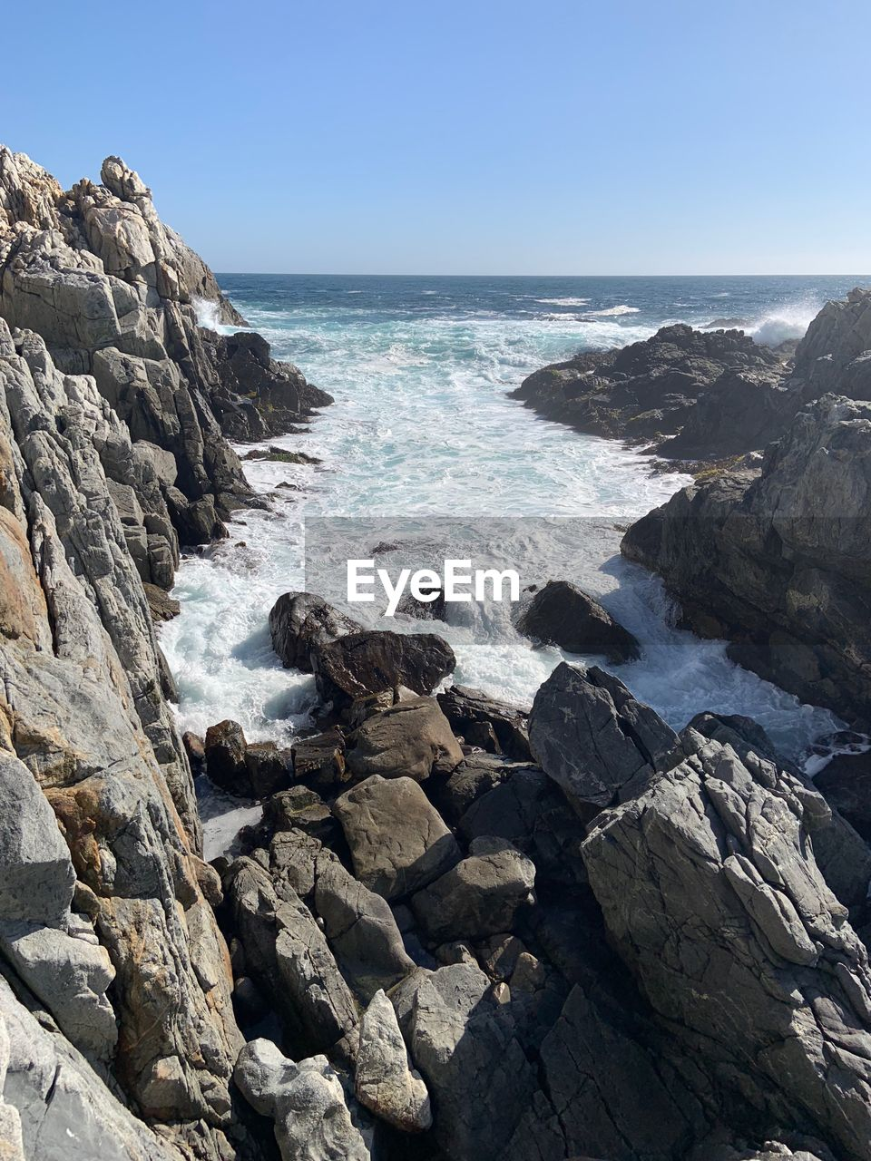 sea, rock, rock - object, solid, water, sky, horizon over water, horizon, land, beauty in nature, scenics - nature, beach, nature, clear sky, day, motion, rock formation, wave, no people, outdoors, rocky coastline, breaking, eroded