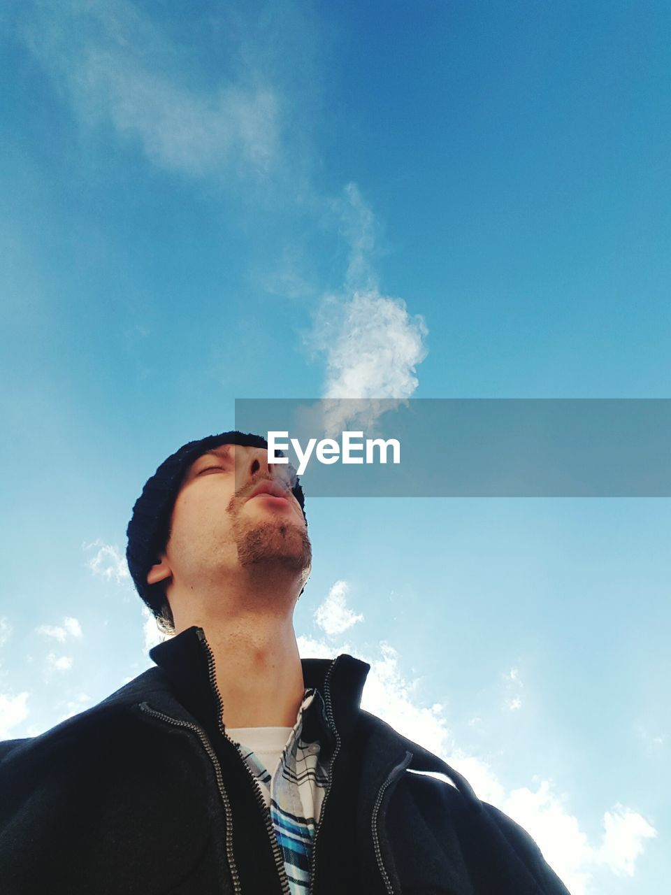 low angle view, sky, looking up, one person, real people, young adult, leisure activity, casual clothing, headshot, cloud - sky, young men, day, lifestyles, outdoors, young women