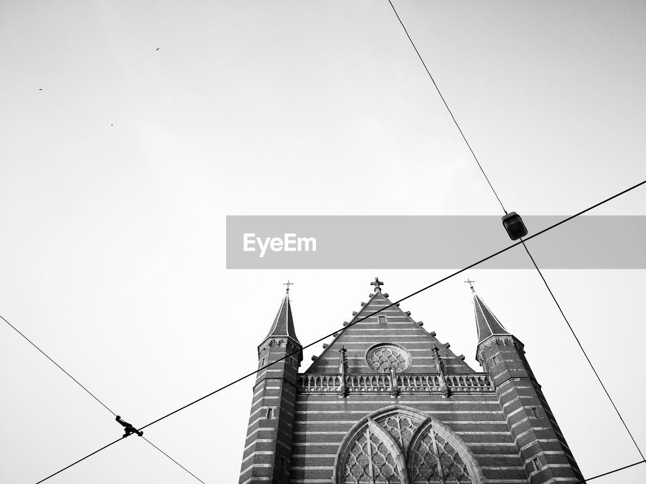built structure, architecture, sky, low angle view, building exterior, cable, building, nature, no people, religion, belief, place of worship, spirituality, clear sky, day, copy space, travel destinations, tower, tourism, power line, outdoors, electricity, spire
