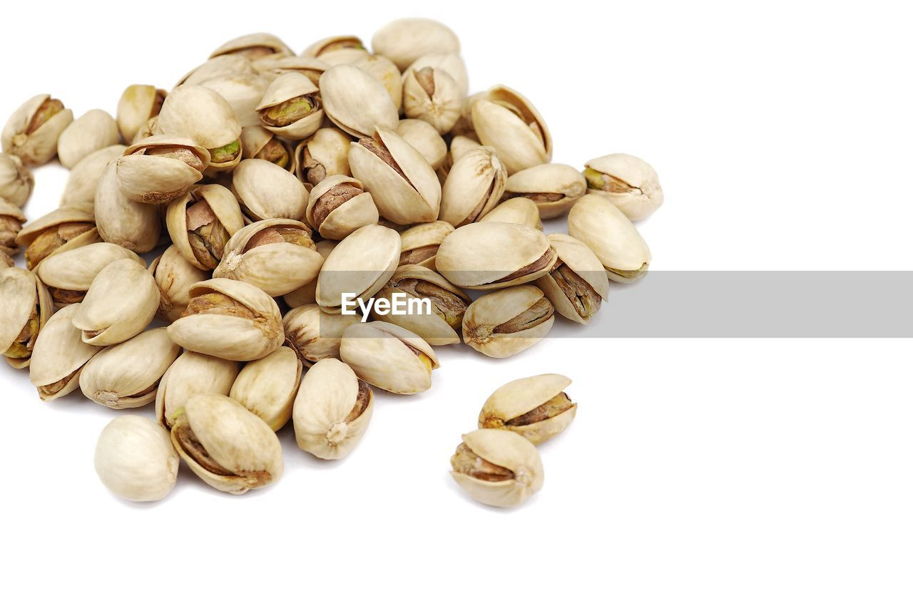 white background, studio shot, food and drink, food, wellbeing, large group of objects, healthy eating, indoors, still life, nut - food, nut, close-up, freshness, no people, cut out, heap, abundance, brown, pistachio, high angle view, snack, dieting