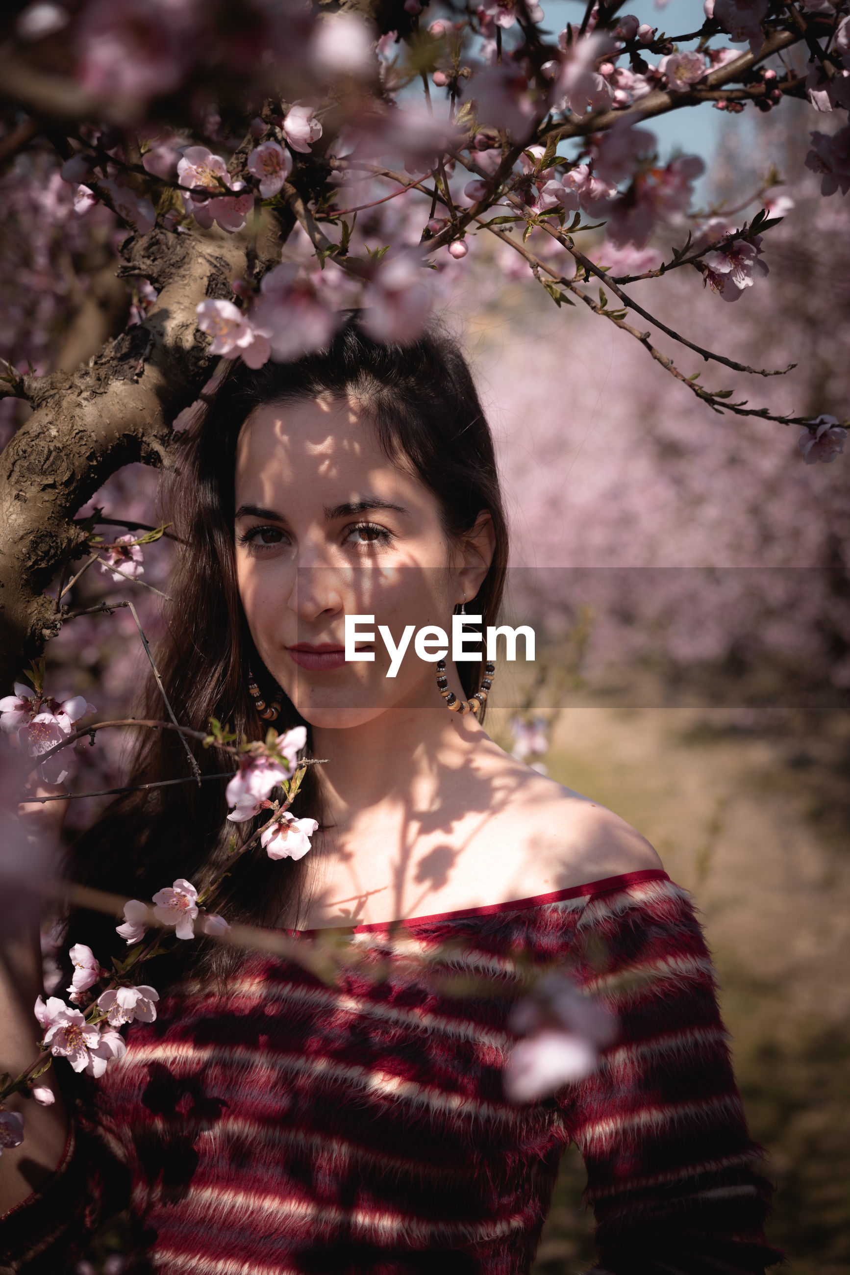 PORTRAIT OF BEAUTIFUL WOMAN WITH CHERRY BLOSSOM
