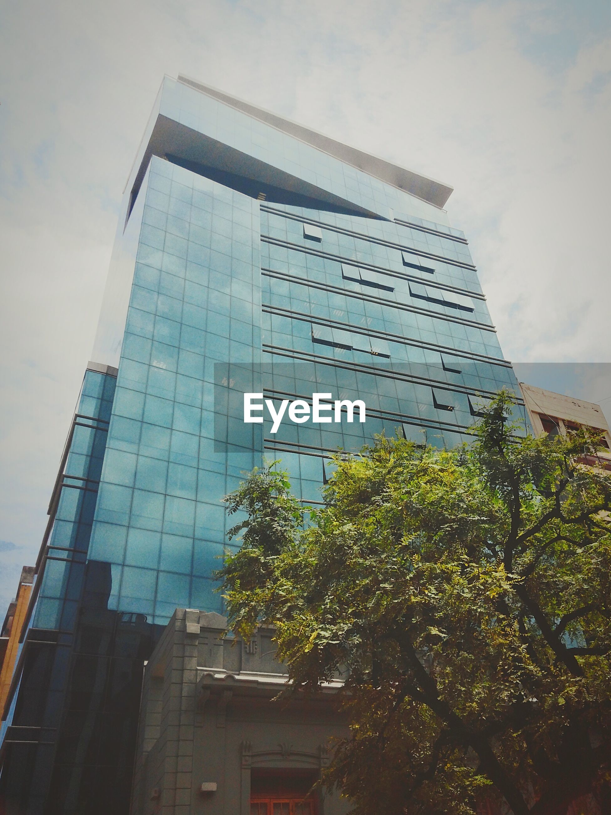 building exterior, architecture, built structure, low angle view, modern, skyscraper, office building, city, tall - high, sky, tower, building, glass - material, cloud - sky, tall, reflection, day, cloud, development, outdoors