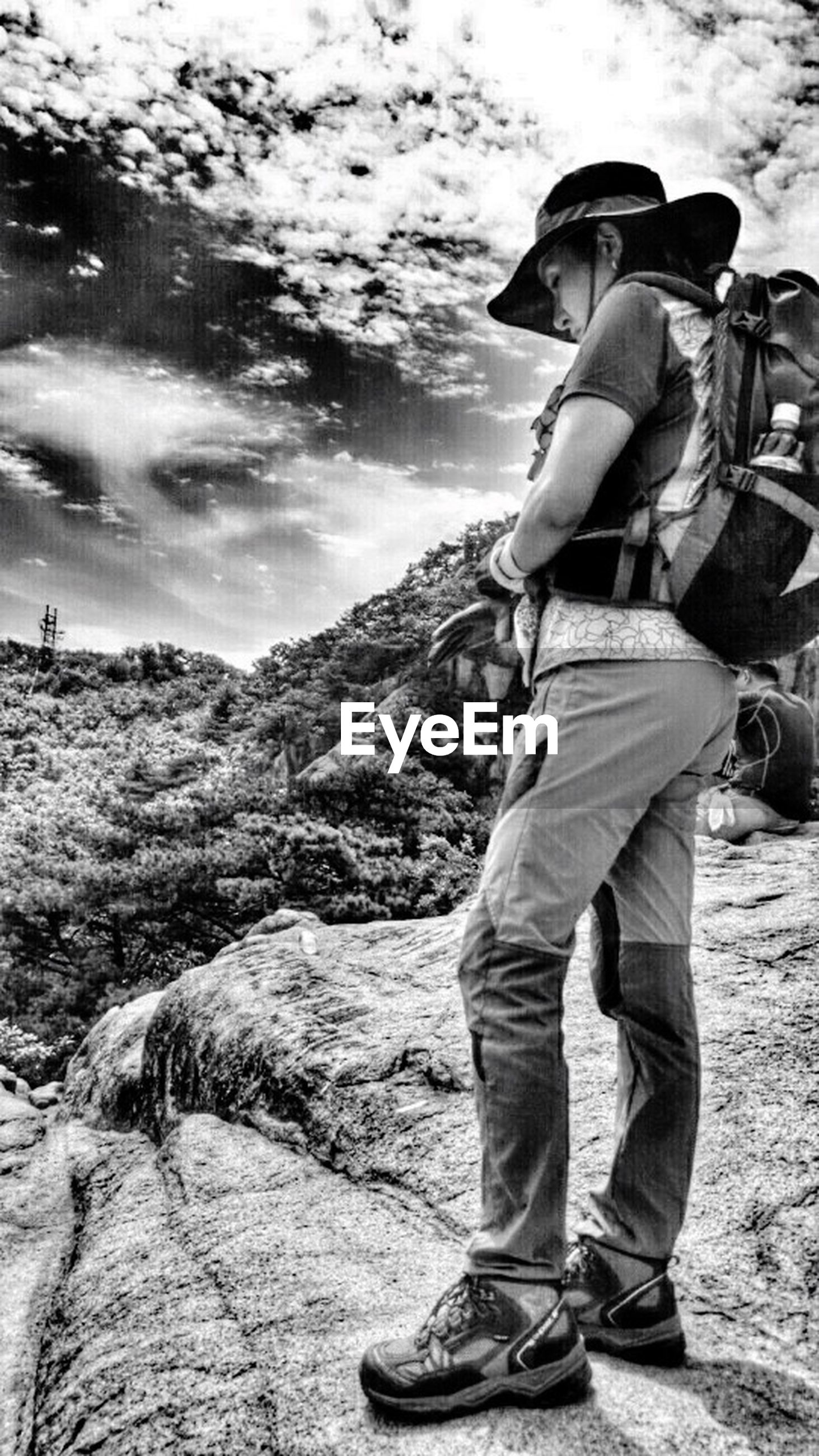 lifestyles, leisure activity, casual clothing, men, rock - object, standing, water, full length, sky, rear view, young adult, rock formation, vacations, person, three quarter length, nature, young men, mountain