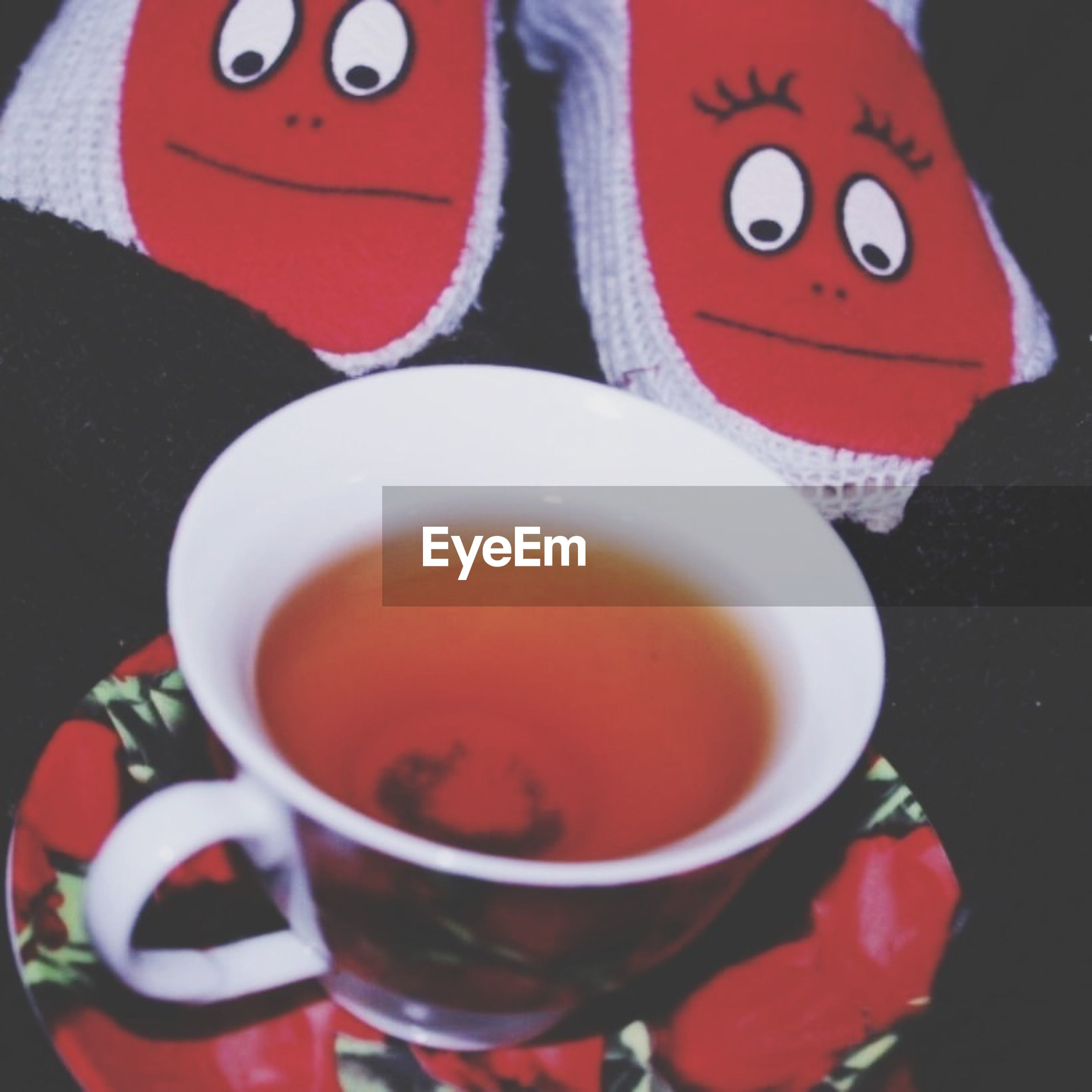 indoors, coffee cup, drink, food and drink, refreshment, coffee - drink, red, cup, coffee, table, still life, saucer, close-up, freshness, high angle view, tea cup, spoon, frothy drink, communication, directly above