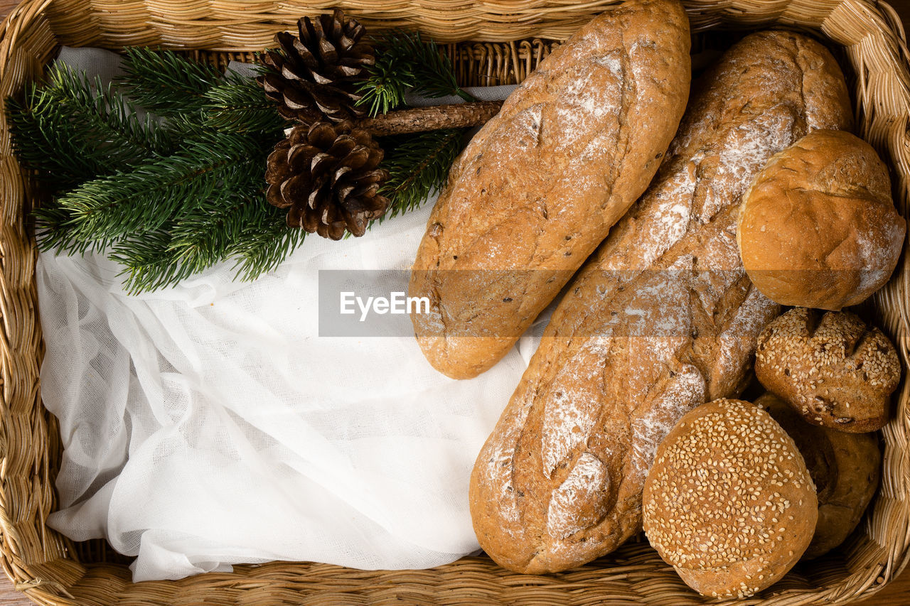 food and drink, food, freshness, indoors, bread, no people, still life, close-up, high angle view, loaf of bread, directly above, baked, healthy eating, basket, table, wellbeing, brown, choice, ready-to-eat, variation, french food, brown bread