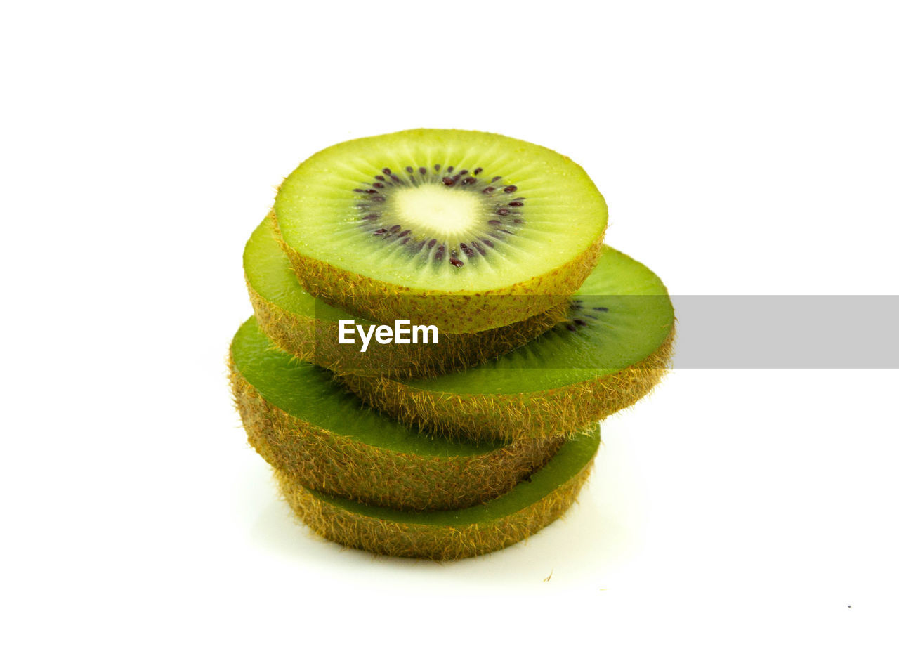 food and drink, food, studio shot, healthy eating, kiwi, green color, fruit, white background, wellbeing, freshness, kiwi - fruit, still life, close-up, indoors, no people, slice, cut out, cross section, group of objects, healthy lifestyle, ripe, snack