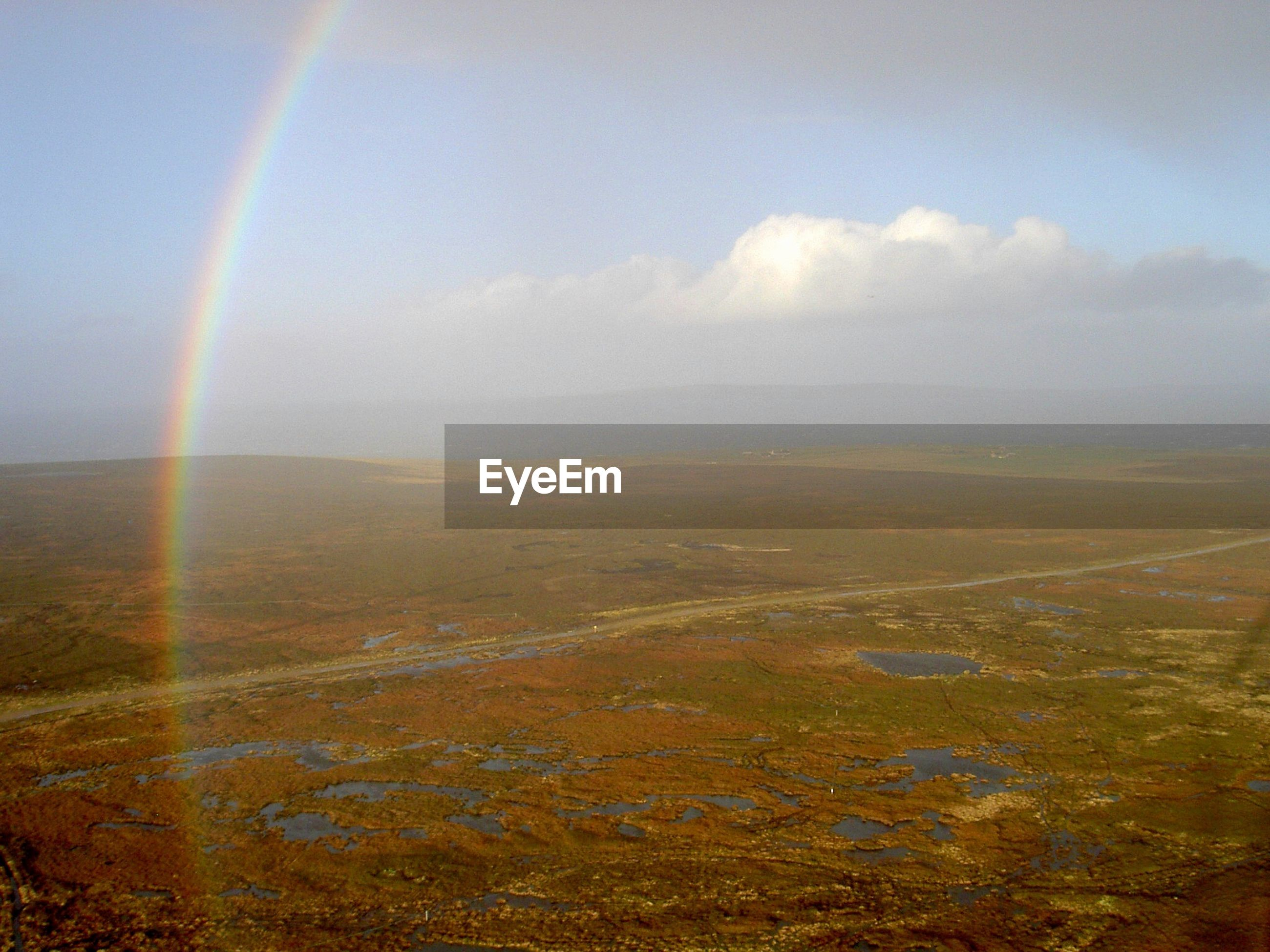 Scenic view of rainbow over landscape