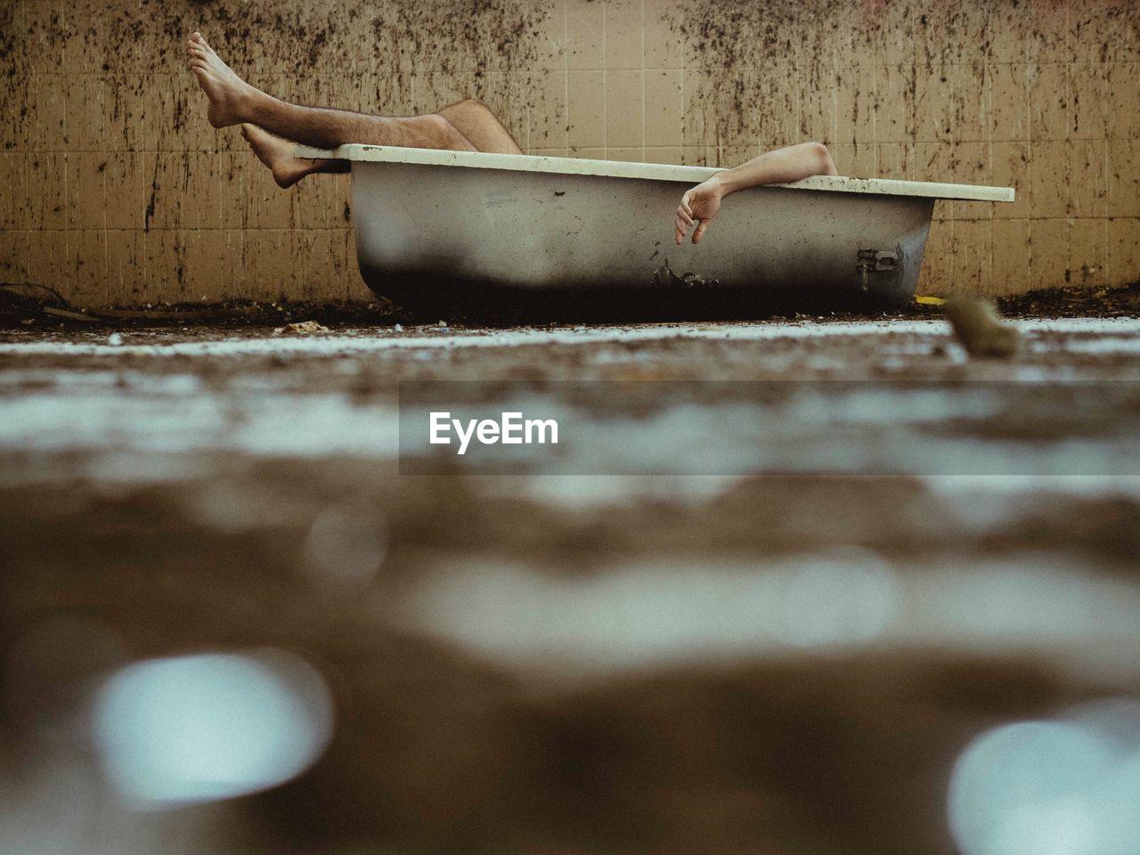 View Of Man Lying In Bath