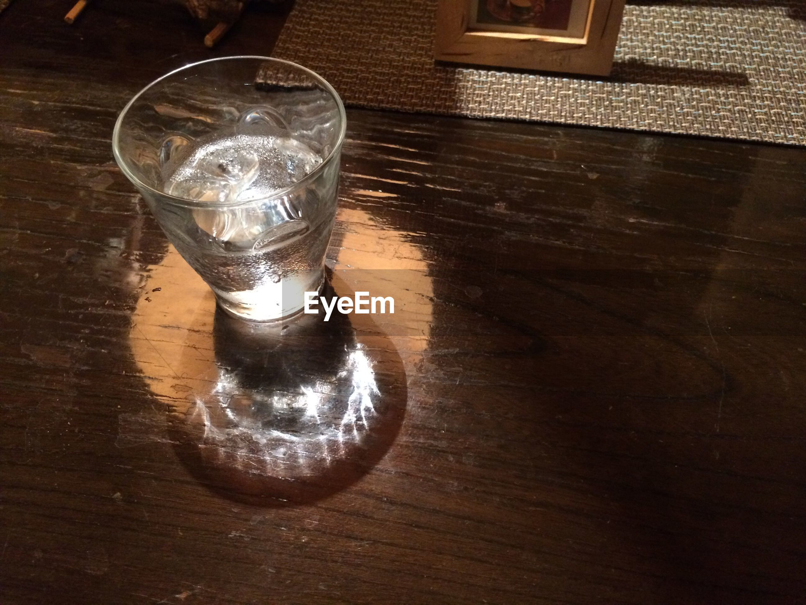 High angle view of half full glass on table