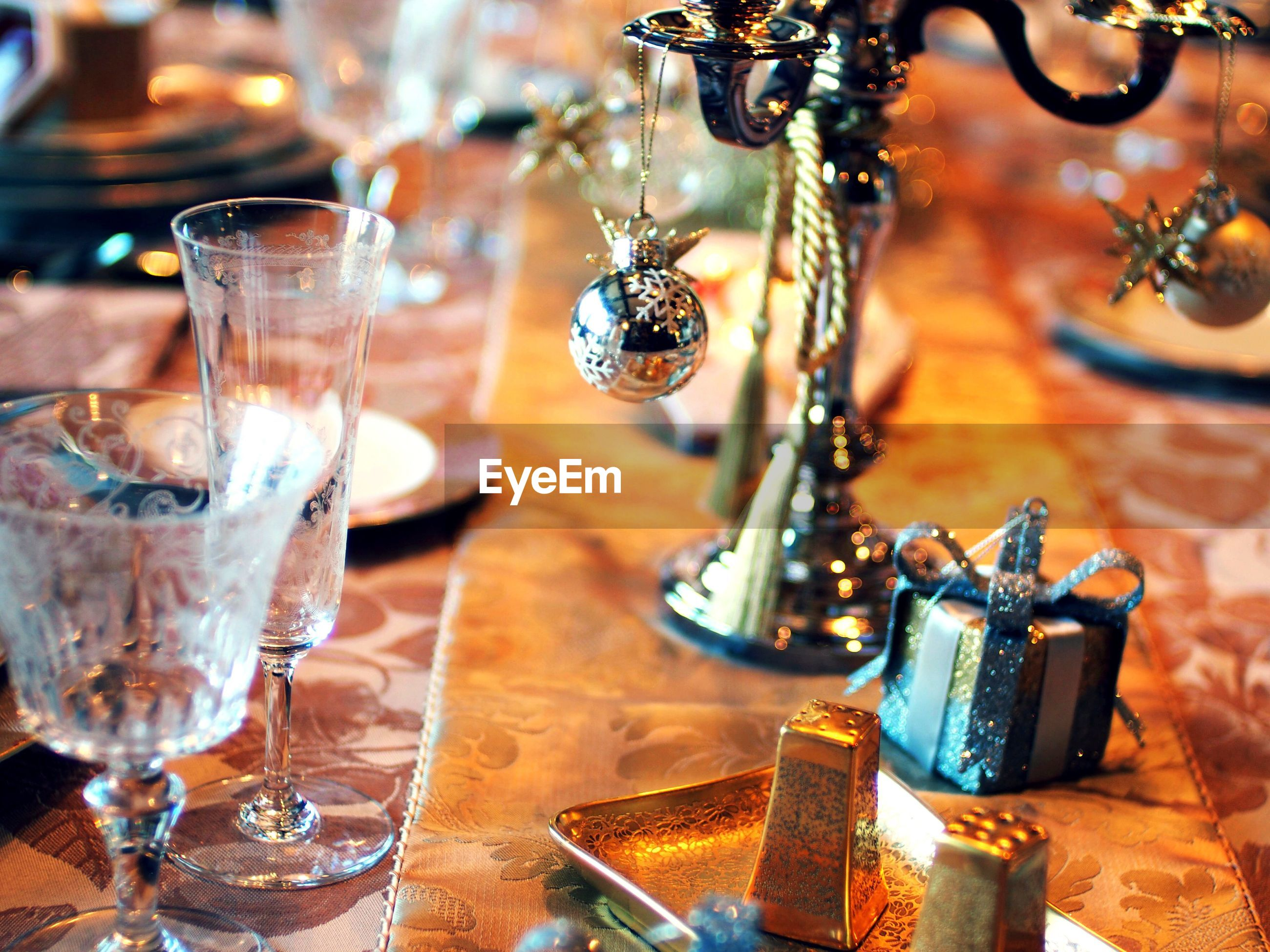 indoors, focus on foreground, table, close-up, insect, hanging, animal themes, glass - material, selective focus, no people, decoration, still life, metal, day, one animal, animals in the wild, nature, wood - material, transparent