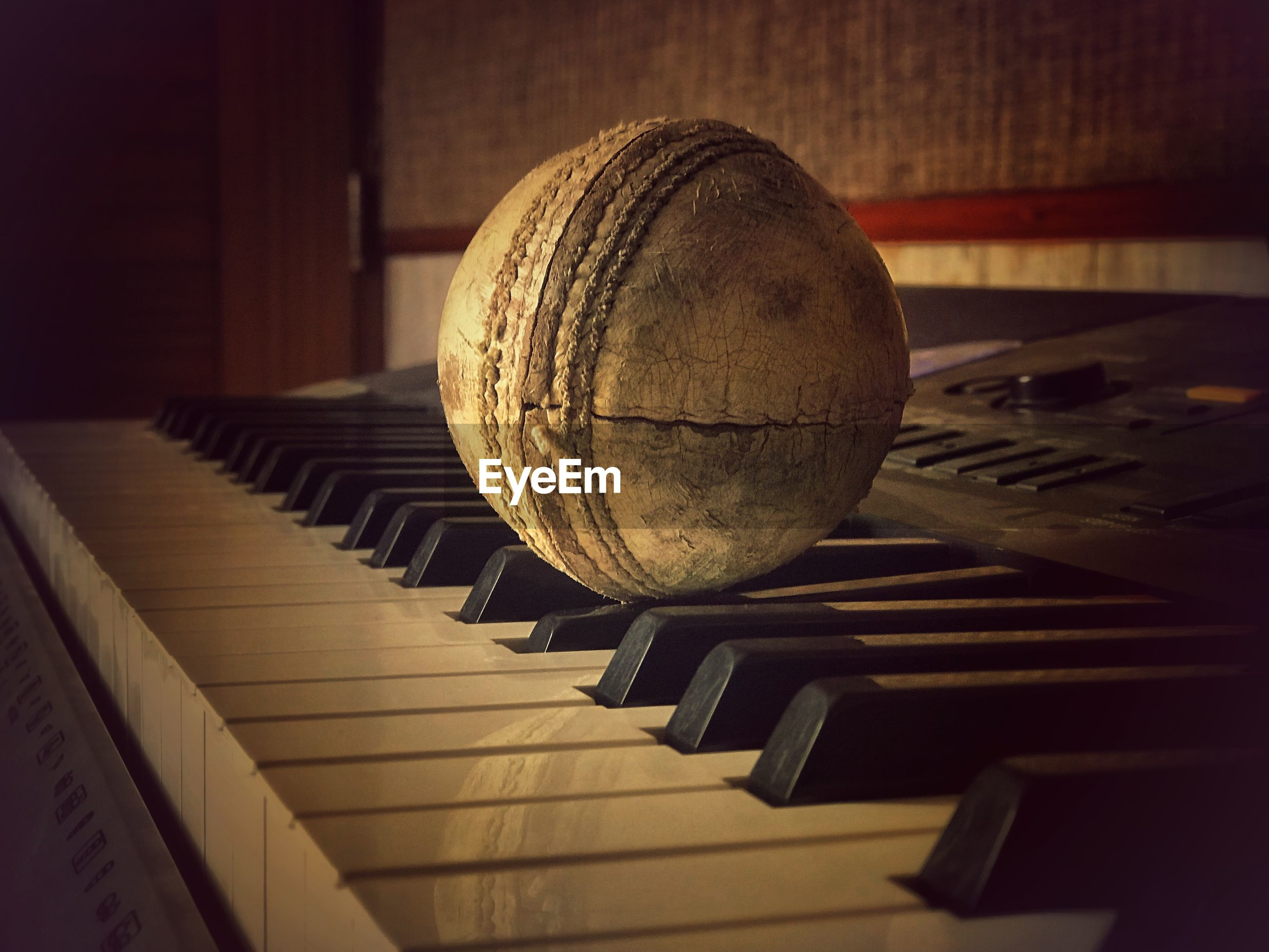 Close-up of ball on piano