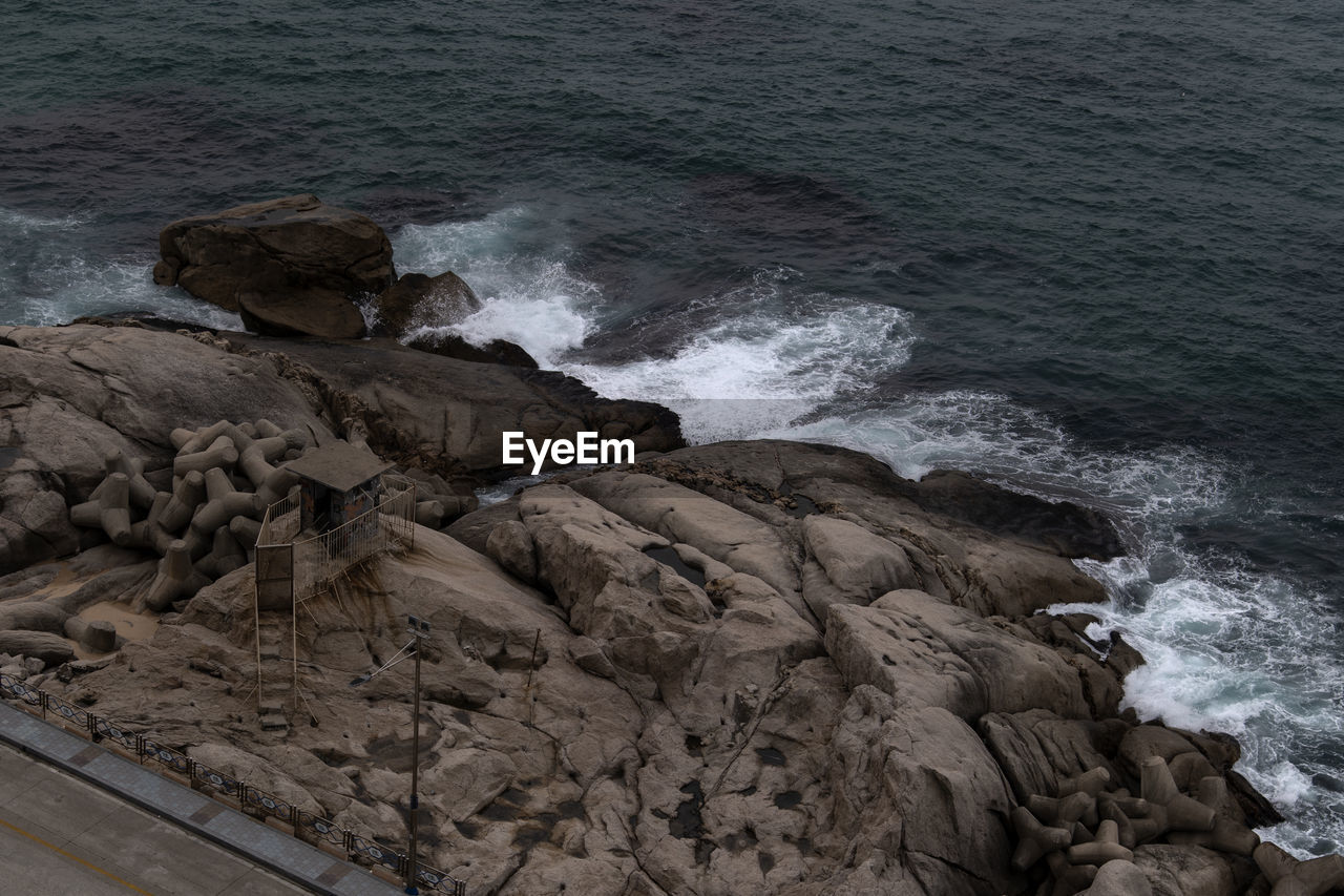 sea, water, rock, rock - object, motion, solid, wave, beauty in nature, nature, no people, beach, power, land, sport, rock formation, aquatic sport, power in nature, day, outdoors, breaking, hitting, flowing water, rocky coastline