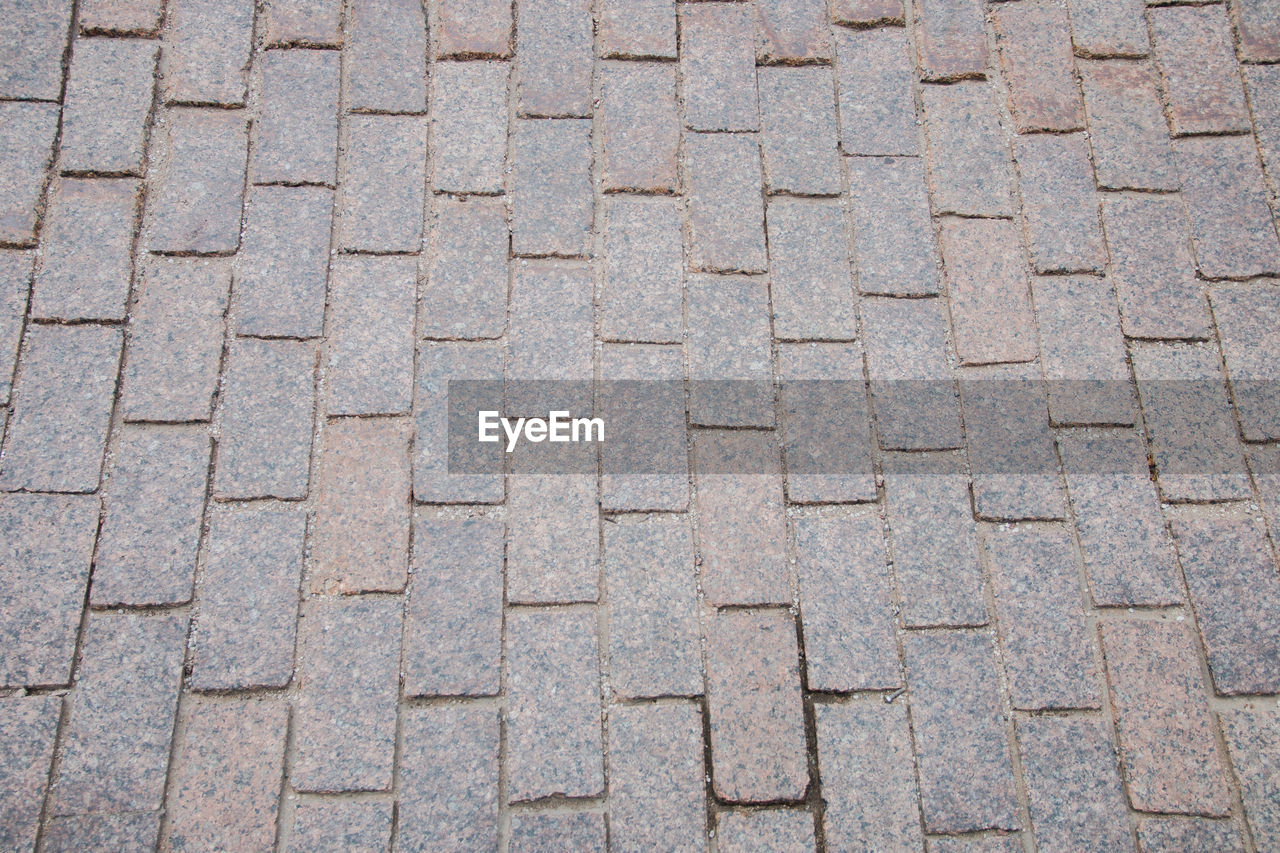 pattern, backgrounds, full frame, no people, textured, repetition, day, gray, high angle view, in a row, footpath, design, shape, close-up, street, stone, outdoors, solid, nature, geometric shape, paving stone, textured effect, concrete