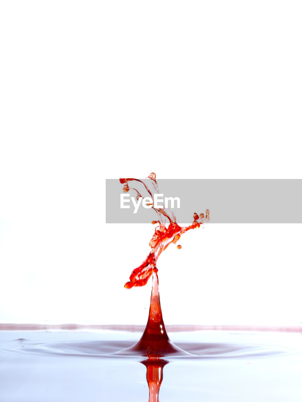 studio shot, white background, splashing, red, water, indoors, drop, motion, copy space, waterfront, close-up, no people, high-speed photography, rippled, nature, water surface, orange color, freshness, purity