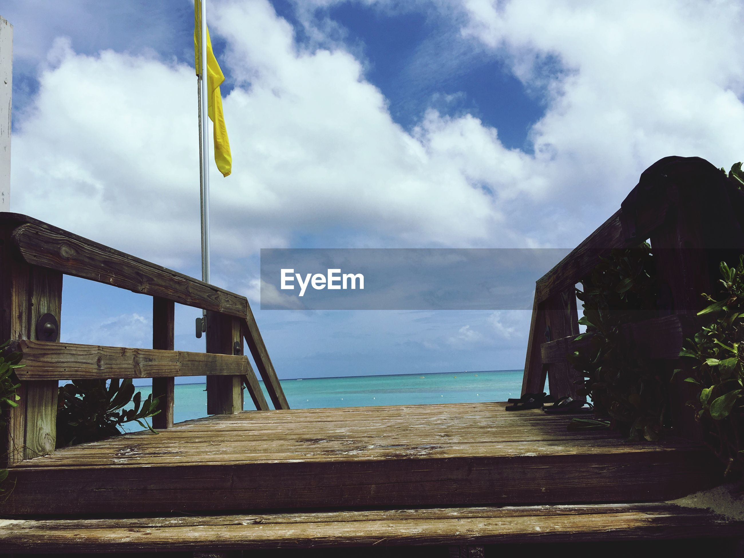 sky, sea, cloud - sky, wood - material, water, railing, pier, cloud, built structure, cloudy, horizon over water, nature, tranquility, outdoors, wood, architecture, tranquil scene, beach, wooden, day