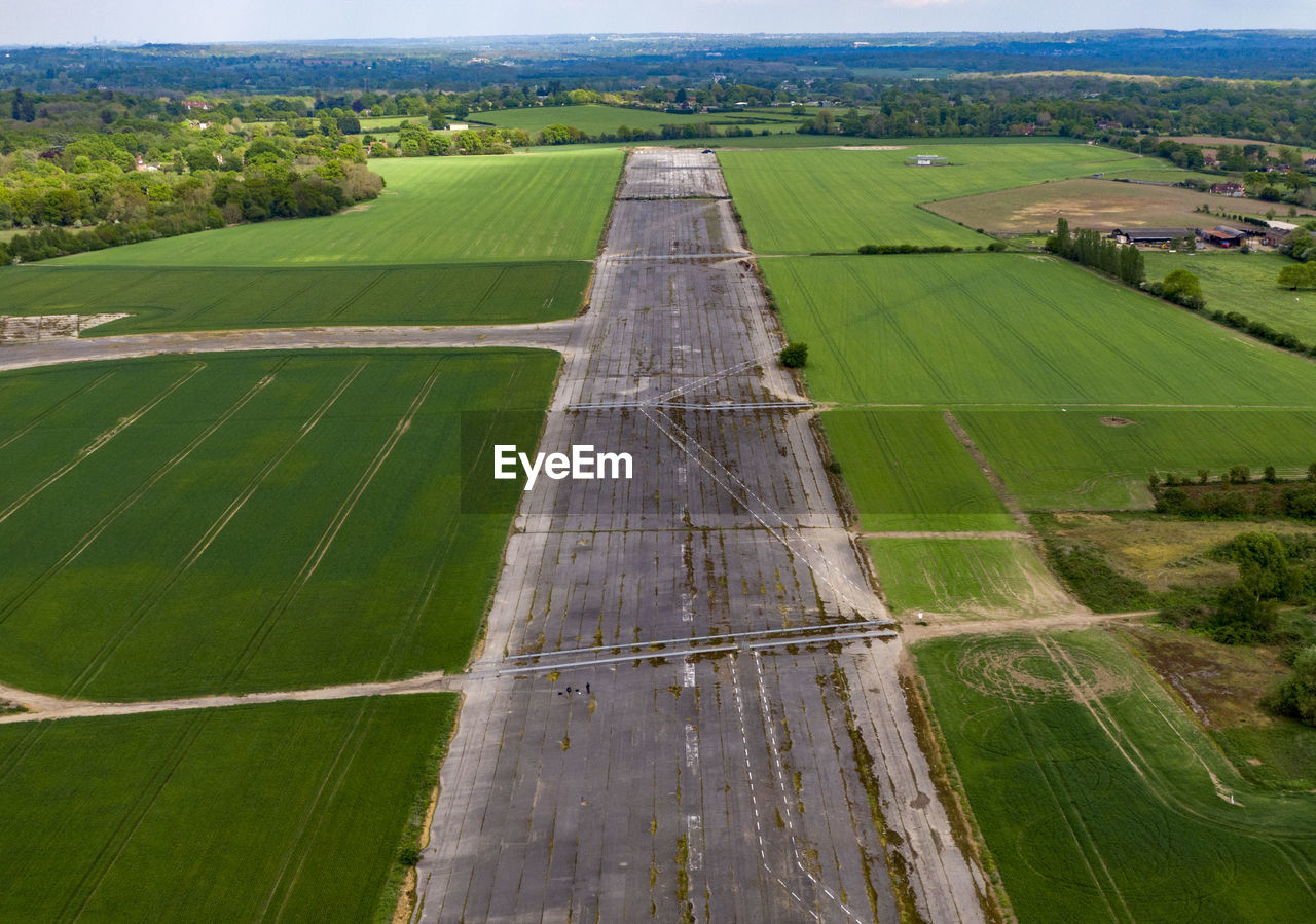 environment, landscape, agriculture, green color, patchwork landscape, land, aerial view, field, rural scene, farm, nature, day, no people, outdoors, tranquil scene, scenics - nature, grass, plant, high angle view, beauty in nature, aerospace industry