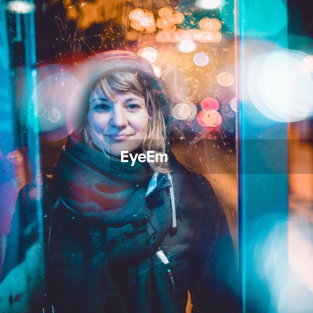 real people, night, multi colored, one person, standing, childhood, looking at camera, front view, leisure activity, portrait, lifestyles, outdoors, illuminated, happiness, smiling, blond hair, young adult, young women, close-up, people