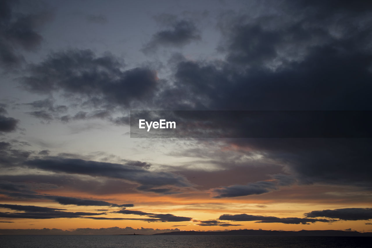 cloud - sky, sky, beauty in nature, scenics - nature, sunset, tranquility, tranquil scene, orange color, no people, low angle view, nature, idyllic, dramatic sky, overcast, storm, cloudscape, outdoors, non-urban scene, dusk, meteorology, ominous