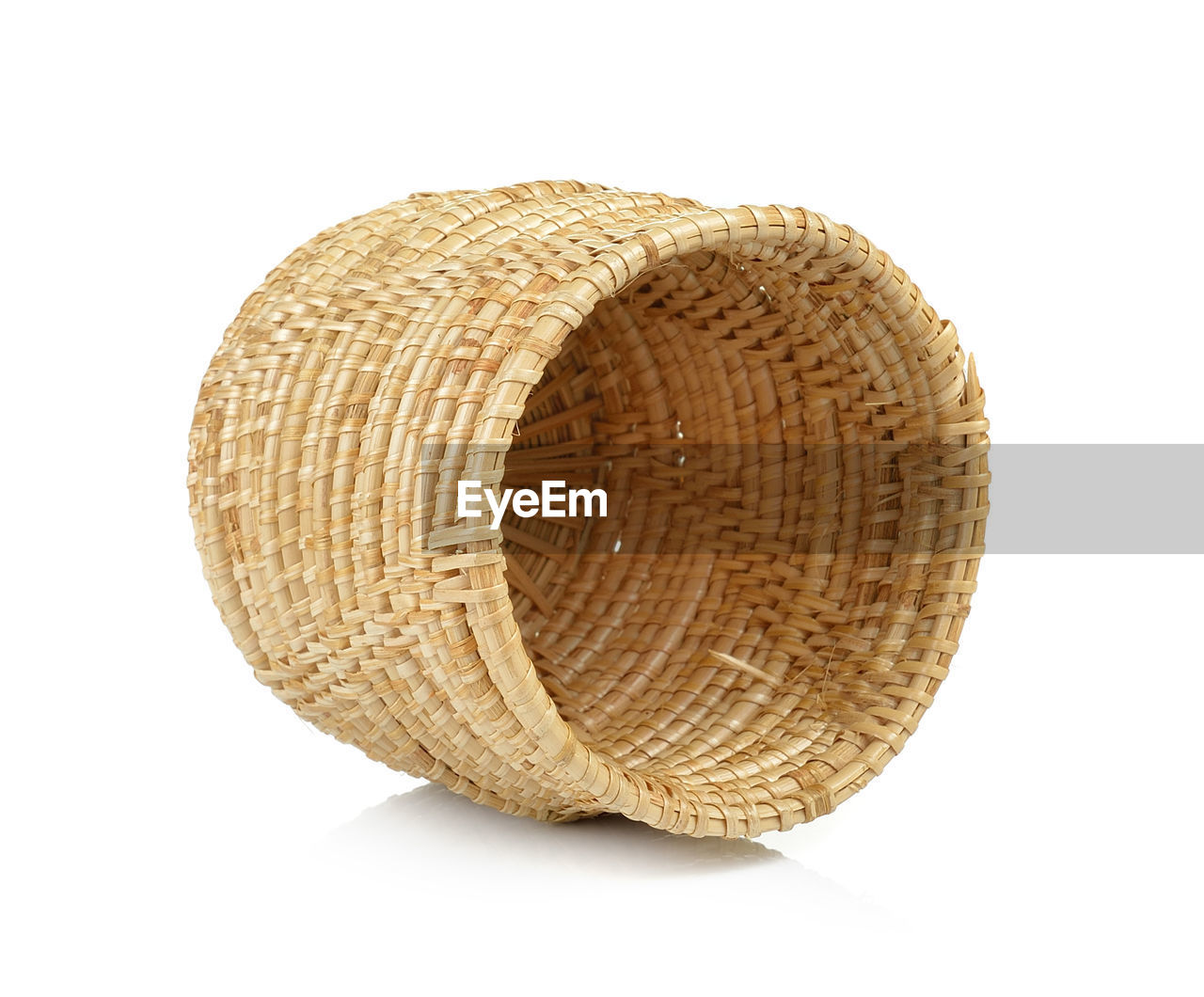 Close-up of wicker basket against white background