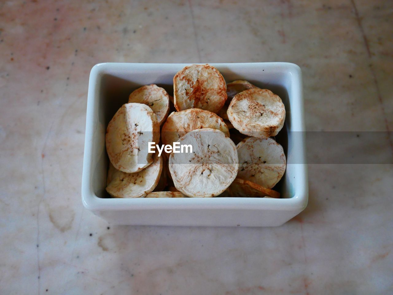 food, food and drink, still life, freshness, indoors, ready-to-eat, bread, high angle view, wellbeing, table, healthy eating, no people, directly above, close-up, container, bowl, baked, tray, large group of objects, slice, snack, breakfast