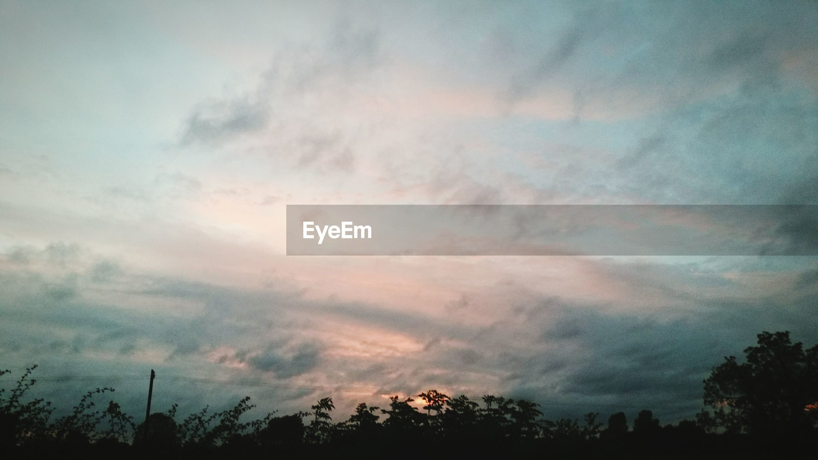 sky, silhouette, cloud - sky, low angle view, cloudy, tranquility, scenics, beauty in nature, tree, tranquil scene, weather, nature, overcast, cloudscape, cloud, storm cloud, dusk, idyllic, dramatic sky, atmospheric mood