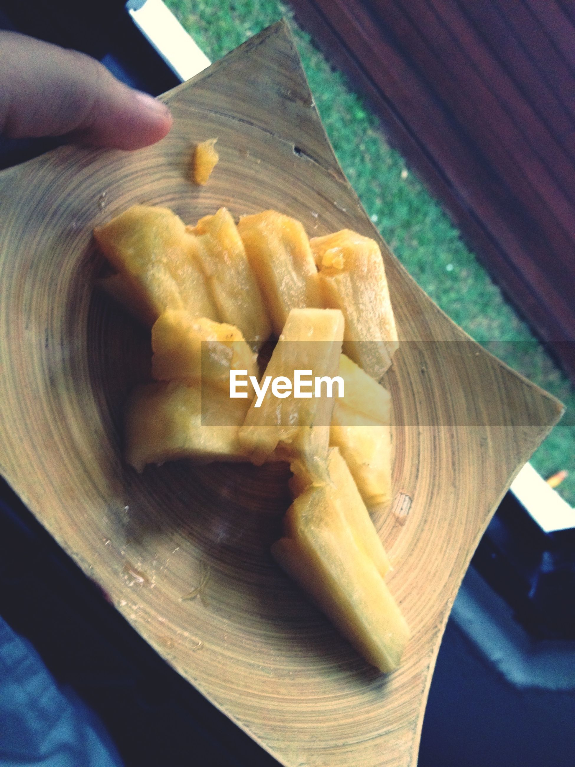 food and drink, food, indoors, freshness, person, table, part of, cropped, healthy eating, high angle view, holding, close-up, ready-to-eat, wood - material, preparation, unrecognizable person, kitchen knife