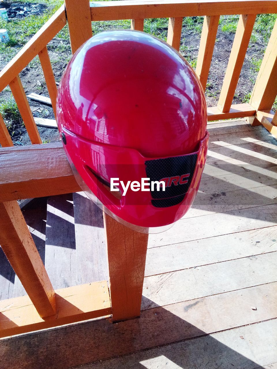 day, sunlight, no people, red, outdoors, wood - material, nature, close-up, communication, text, architecture, shadow, seat, railing, ball, safety, security, water, sphere, protection