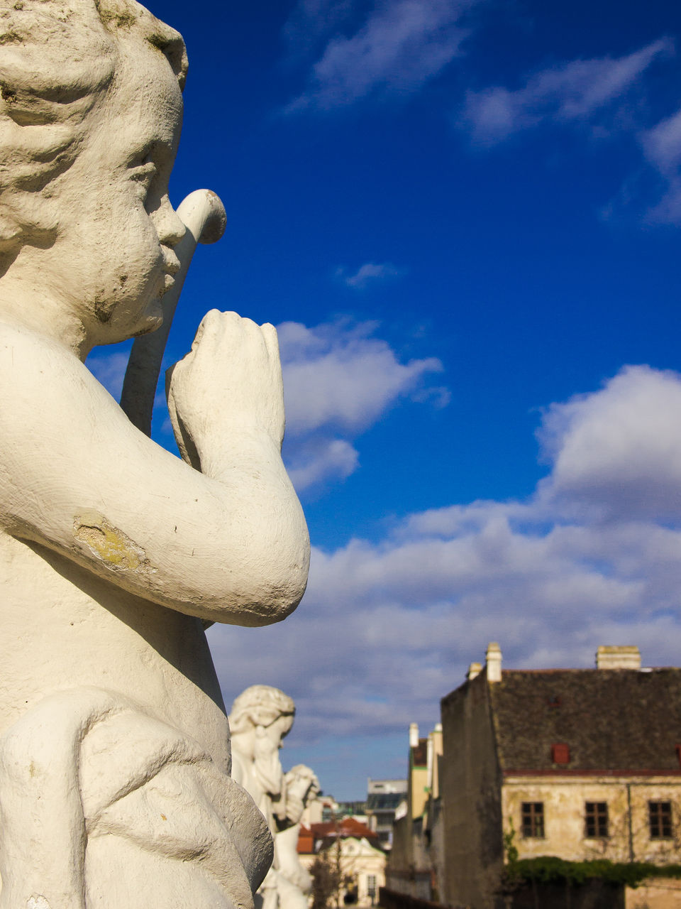 Statues At Belvedere Palace Against Blue Sky
