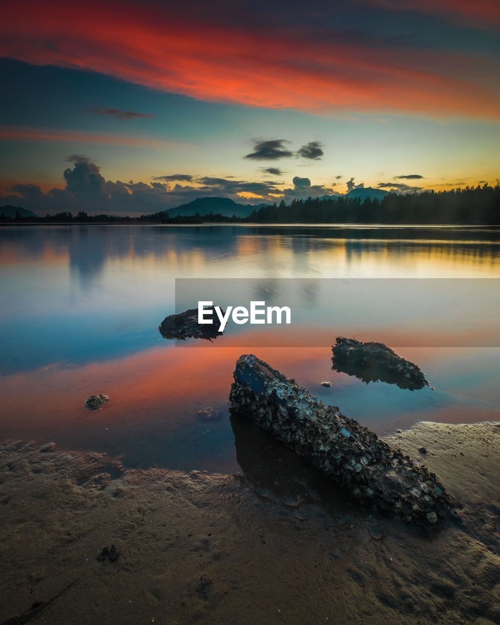 sunset, orange color, nature, beauty in nature, tranquil scene, scenics, sky, tranquility, water, rock - object, reflection, outdoors, no people, cloud - sky, sea, beach, day