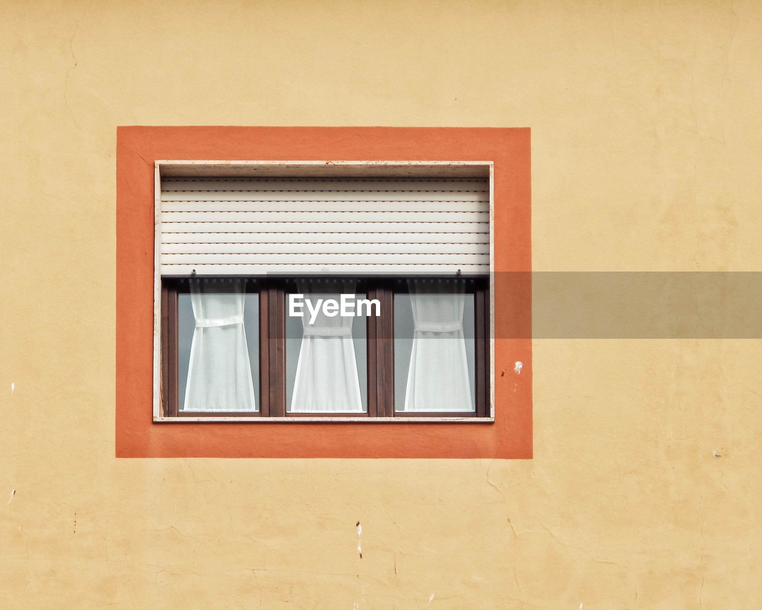 Low angle view of window on wall of building