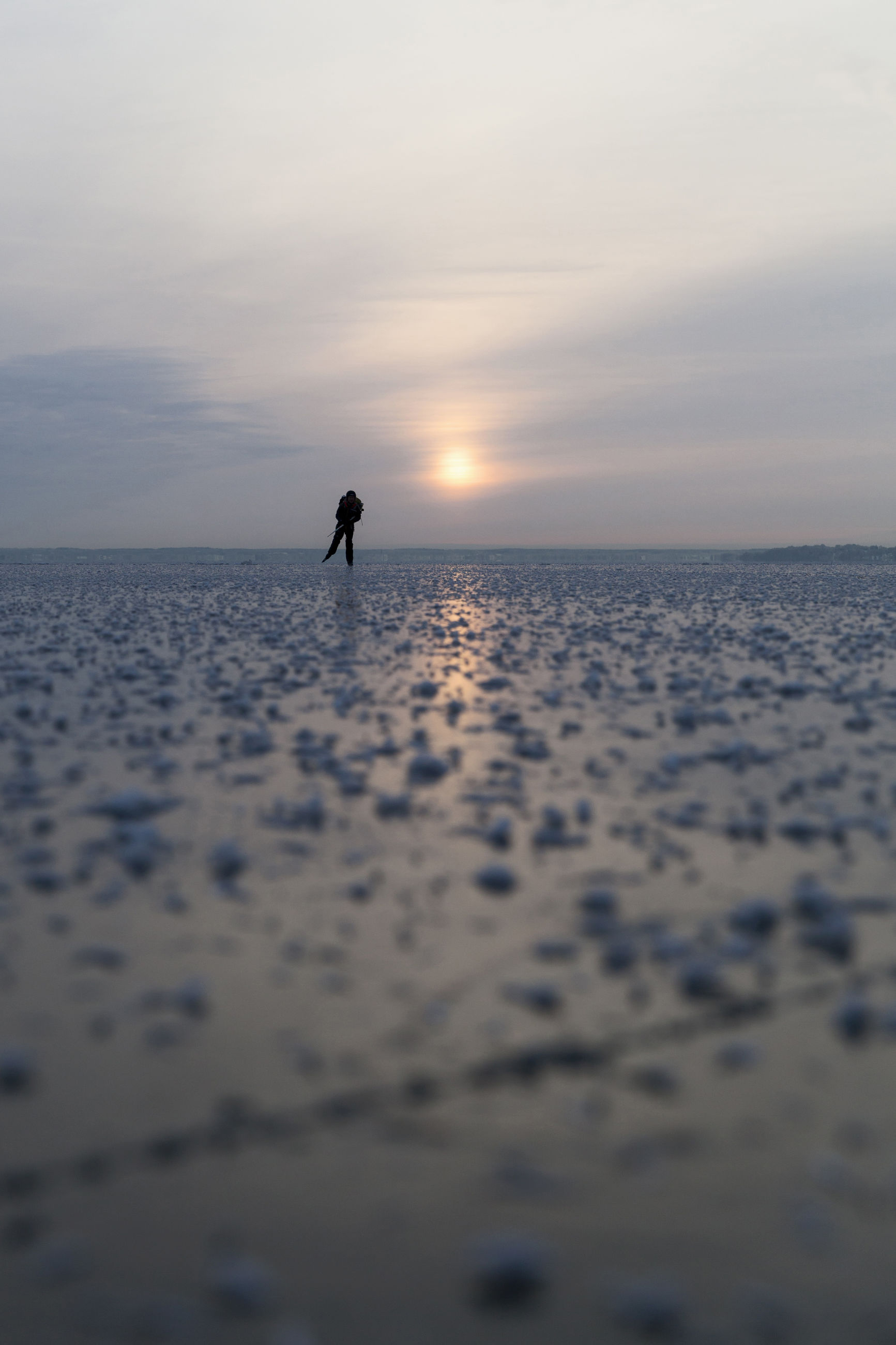 SILHOUETTE PERSON ON SHORE AGAINST SKY DURING SUNSET