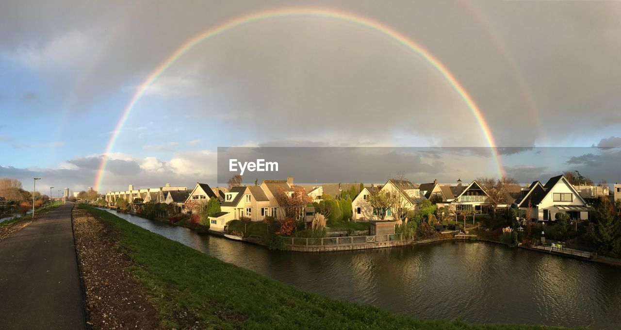 rainbow, double rainbow, cloud - sky, sky, architecture, built structure, building exterior, outdoors, nature, no people, day, arch, water, scenics, beauty in nature, panoramic
