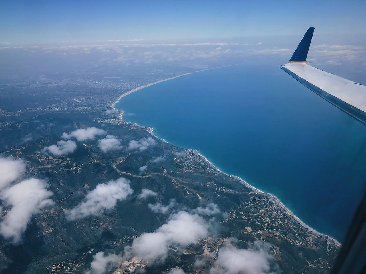 airplane, aerial view, air vehicle, scenics - nature, water, beauty in nature, flying, sea, mode of transportation, no people, transportation, aircraft wing, nature, day, travel, sky, cloud - sky, tranquil scene, mid-air, outdoors