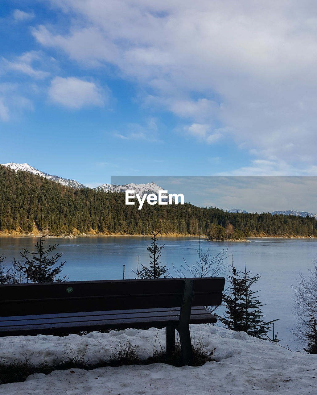 nature, beauty in nature, lake, scenics, tranquility, mountain, sky, water, snow, tranquil scene, cloud - sky, winter, cold temperature, idyllic, no people, mountain range, day, outdoors, tree